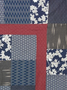 A detail of a patchwork quilt made from Japanese cottons