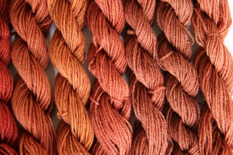 Copper mordanted yarn dyed with madder according to a medieval recipe