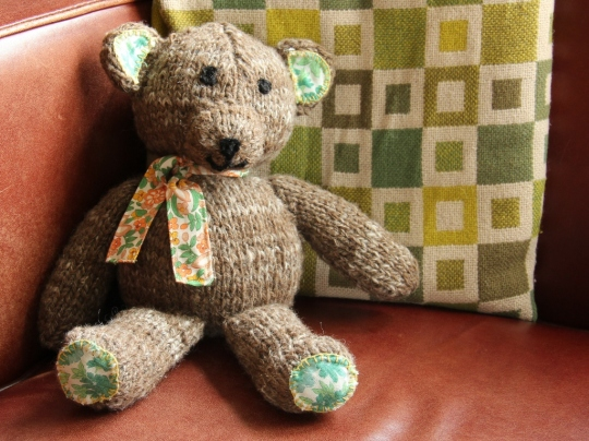 A teddy bear from home spun yarn