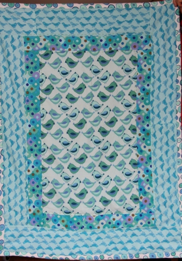 A patchwork baby quilt in Valori Wells cotton flannel