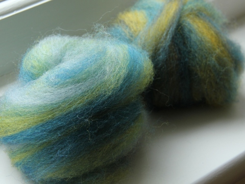 Multi-coloured batts pre-drafted into roving
