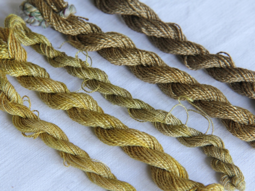 embroidery silk dyed with alchemilla mollis. From bottom left: alum, alum, alum+iron, copper, copper+ iron.