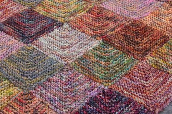 Knitted patchwork blanket in Araucania yarns